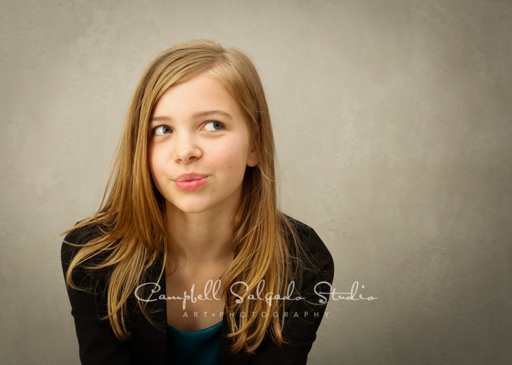 Portrait of girl on modern grey background by family photographers at Campbell Salgado Studio, Portland, Oregon.