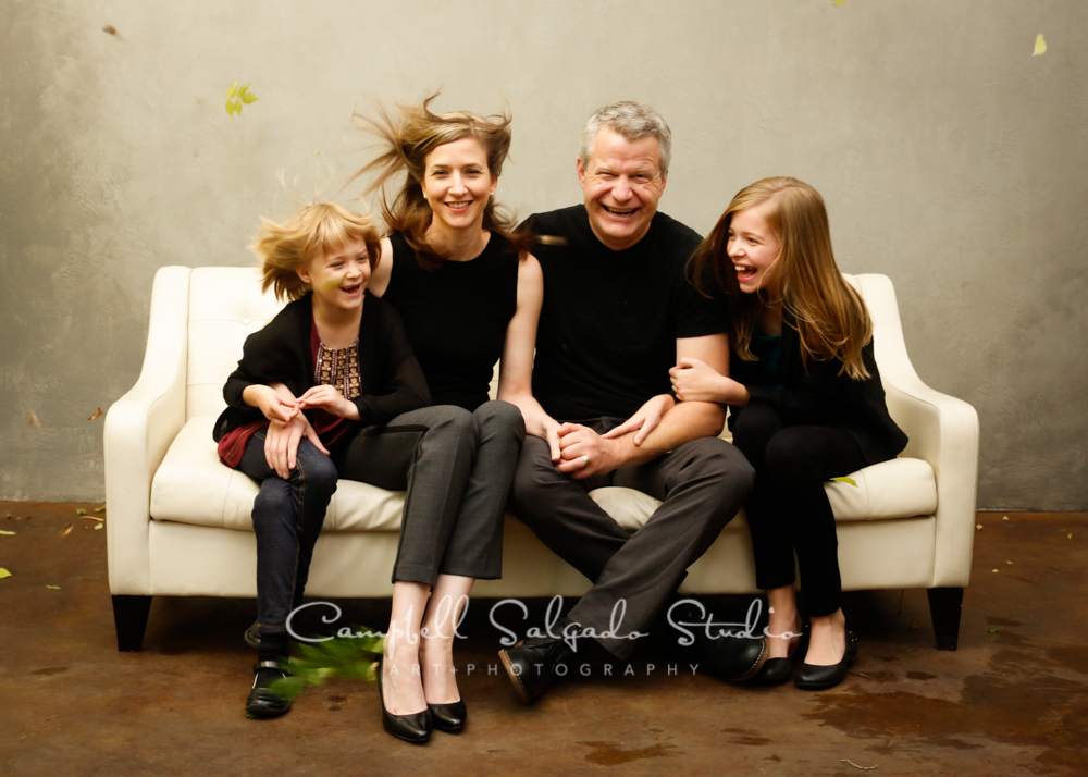 Portrait of family on modern grey background by family photographers at Campbell Salgado Studio, Portland, Oregon.