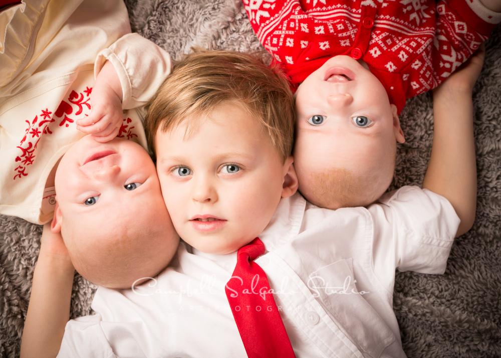 Portrait of siblings on grey blankie by child photographers at Campbell Salgado Studio, Portland, Oregon.