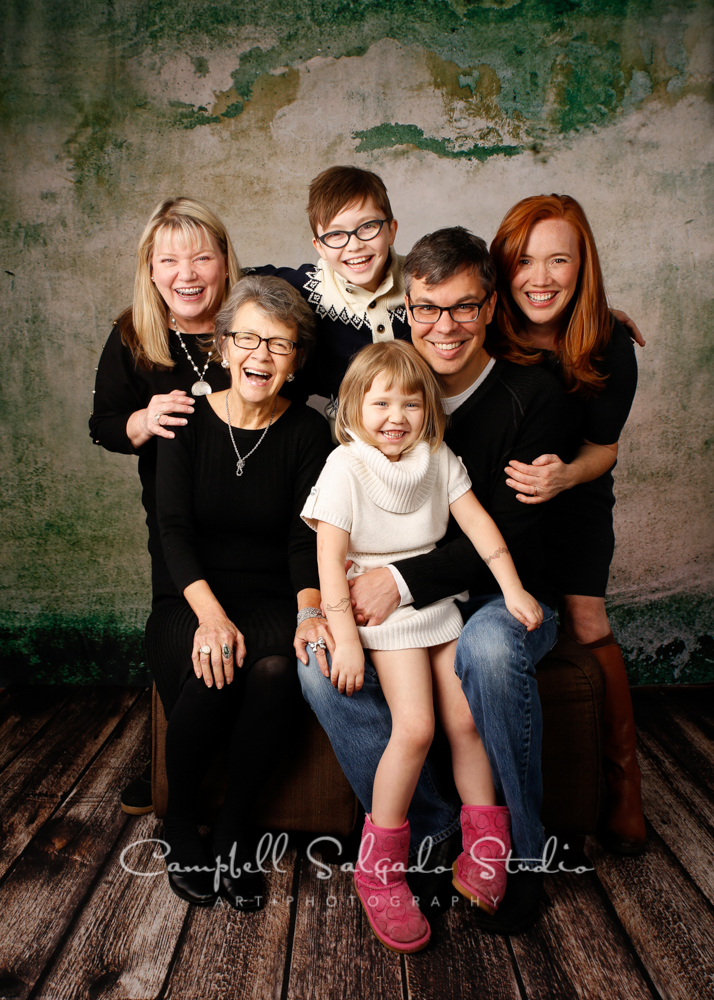 Portrait of multi generational family on abandoned concrete background by family photographers at Campbell Salgado Studio, Portland, Oregon.