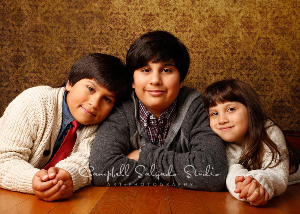 Portrait of kids on amber light backgroundby children's photographers at Campbell Salgado Studio, Portland, Oregon.