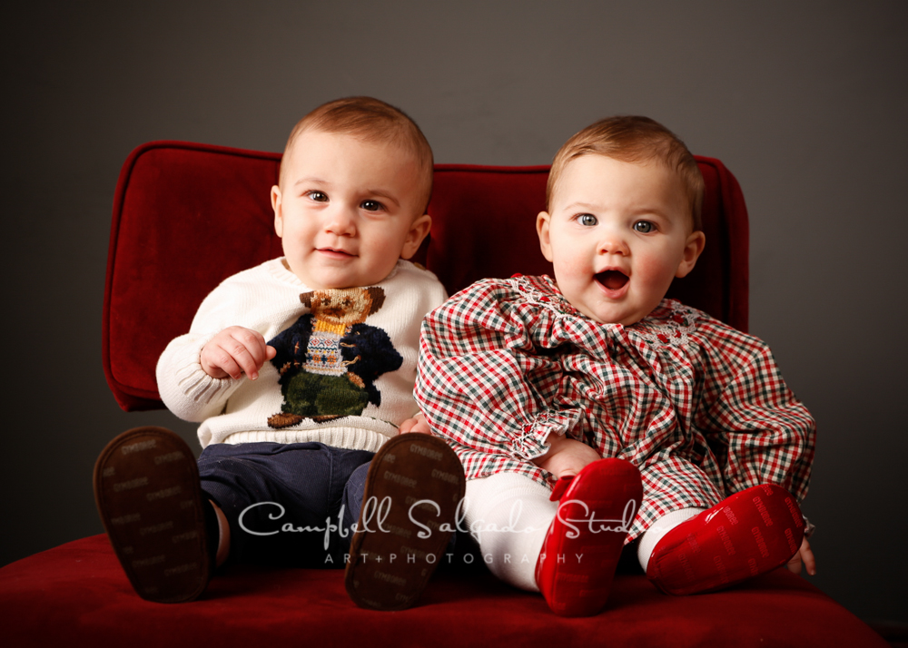 Portrait of twins on gray background by child photographers at Campbell Salgado Studio, Portland, Oregon.