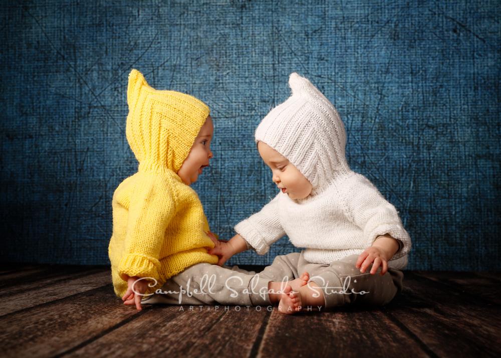 Portrait of twins on denim backgroundby childrens photographers at Campbell Salgado Studio, Portland, Oregon.