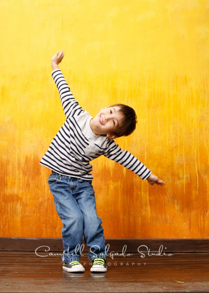 Portrait of boy on liquid sunshine backgroundby child photographers at Campbell Salgado Studio, Portland, Oregon.