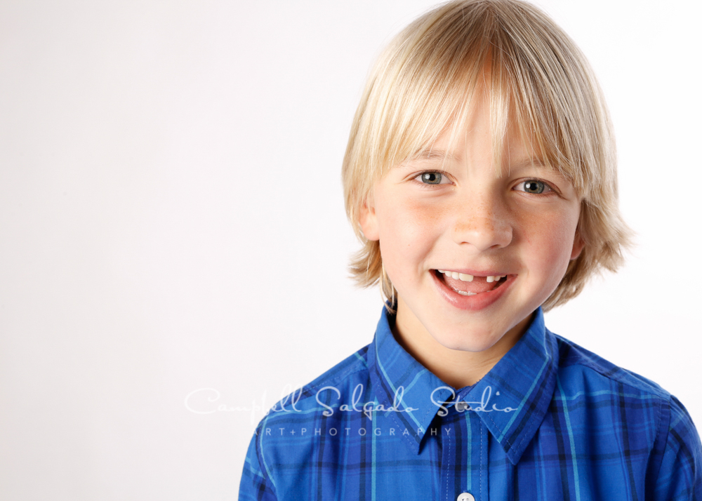 Portrait of child on white background by child photographers at Campbell Salgado Studio, Portland, Oregon.