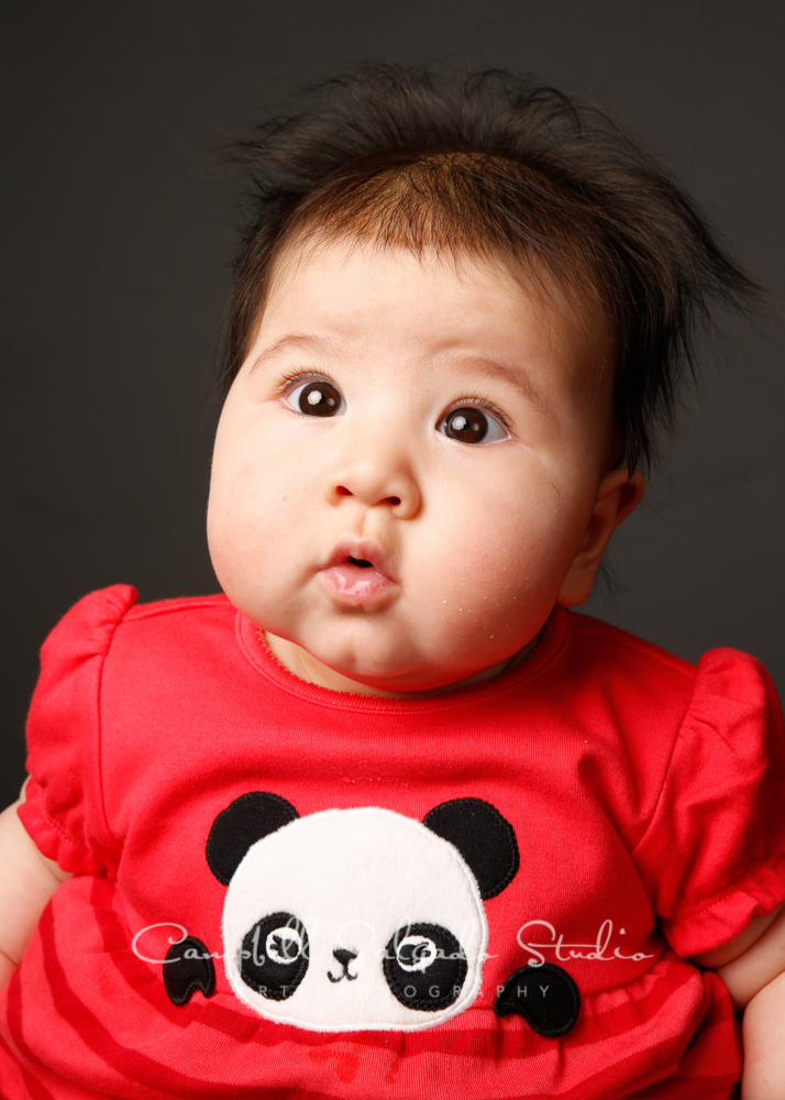 Portrait of baby on grey backgroundby childphotographers at Campbell Salgado Studio, Portland, Oregon.