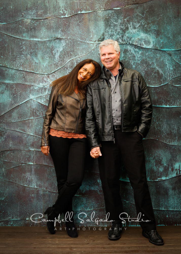 Portrait of couple on copper wave background by couples photographers at Campbell Salgado Studio, Portland, Oregon.
