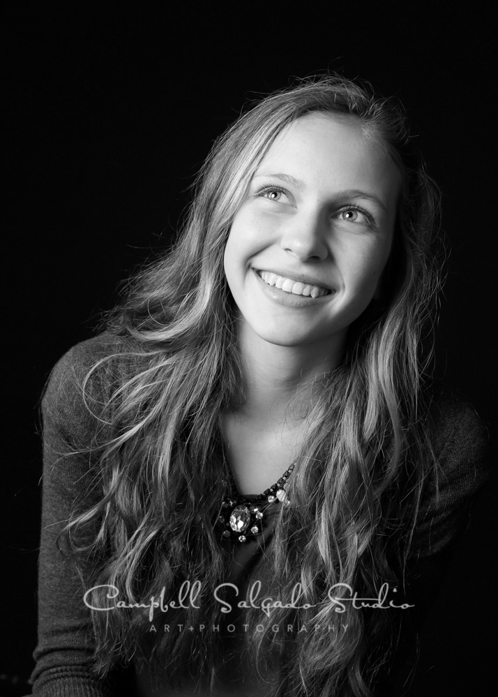 B&W portrait of teen on black background by family photographers at Campbell Salgado Studio, Portland, Oregon.
