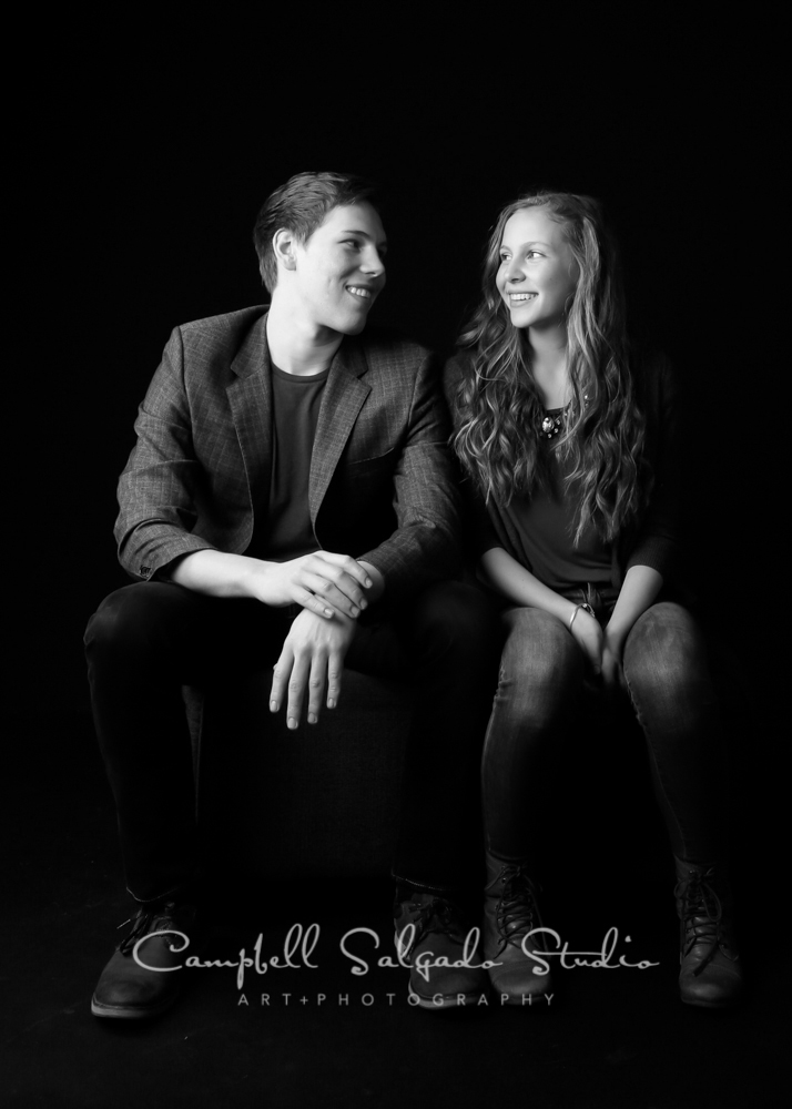 B&W portrait of siblings on black background by family photographers at Campbell Salgado Studio, Portland, Oregon.