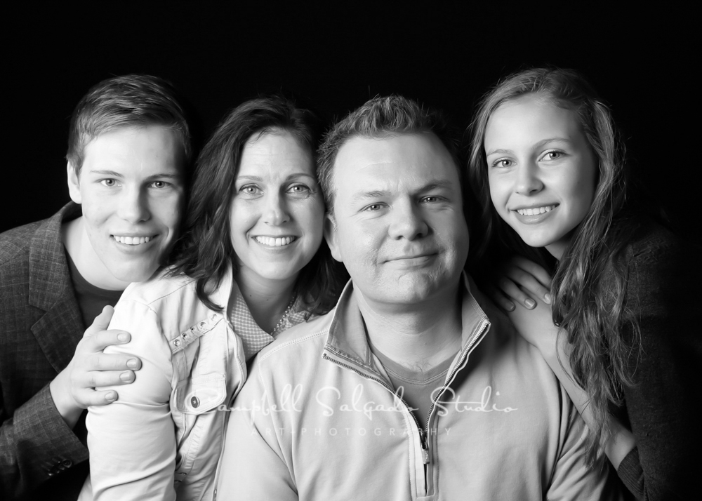 B&W portrait of family on black background by family photographers at Campbell Salgado Studio, Portland, Oregon.