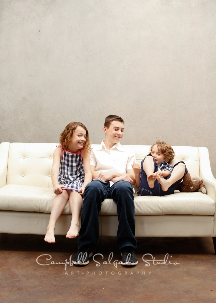 Portrait of kids on modern gray background by child photographers at Campbell Salgado Studio, Portland, Oregon.