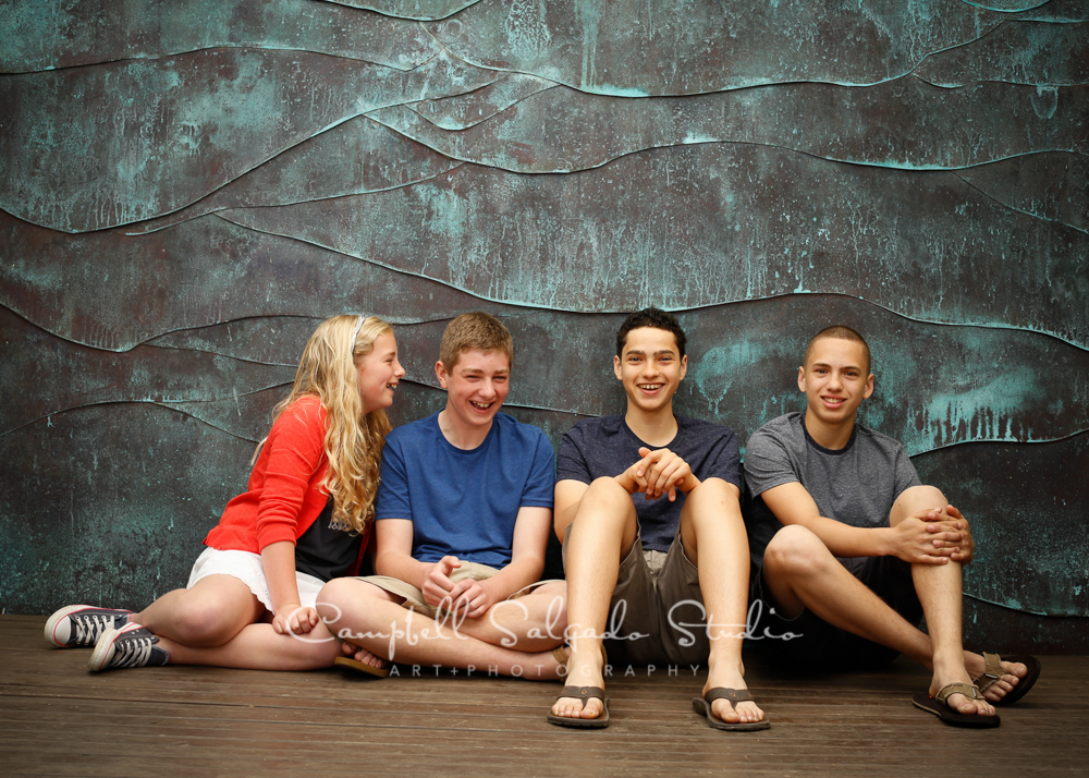 Portrait of siblings on copper wave background by family photographers at Campbell Salgado Studio, Portland, Oregon.