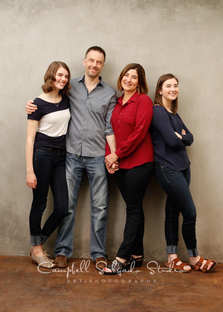 Portrait of familyon modern grey backgroundby family photographers at Campbell Salgado Studio, Portland, Oregon.