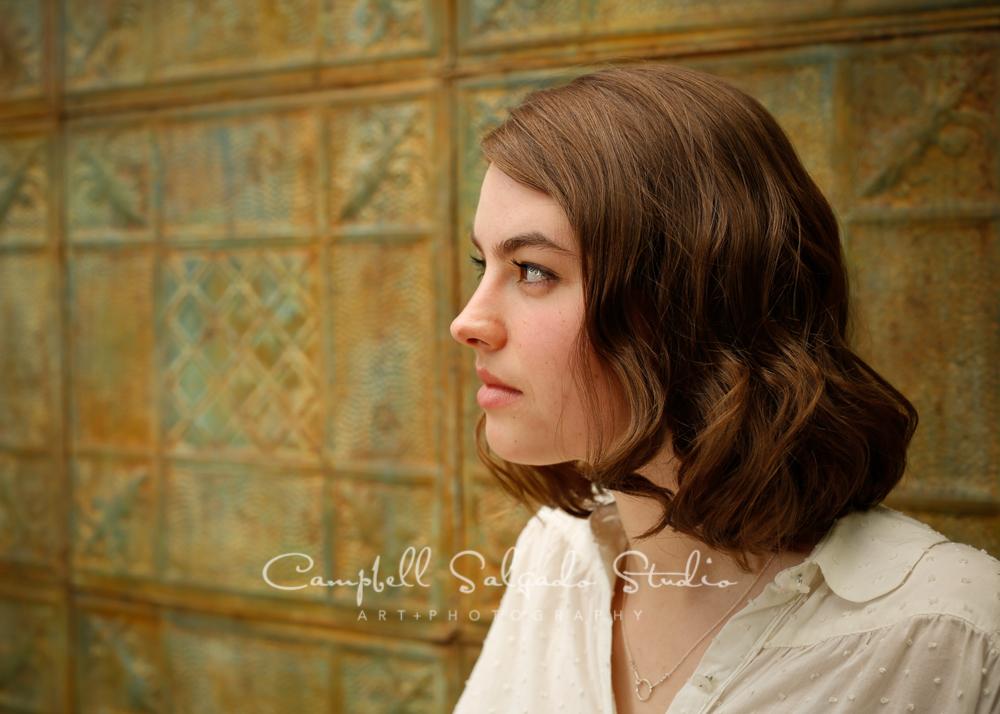 Portrait of girl on vintage colored tinbackgroundby family photographers at Campbell Salgado Studio, Portland, Oregon.