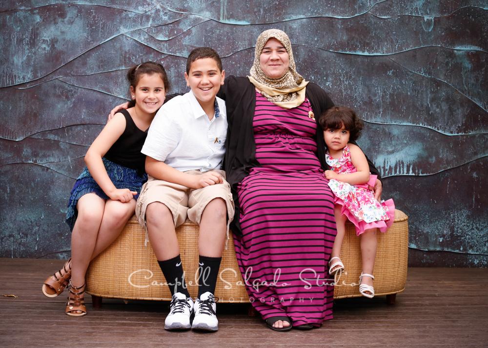Portrait of family on copper wavebackgroundby family photographers at Campbell Salgado Studio, Portland, Oregon.