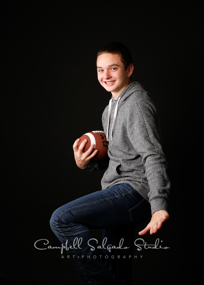 Portrait of teen on black background by teen photographersat Campbell Salgado Studio, Portland, Oregon.