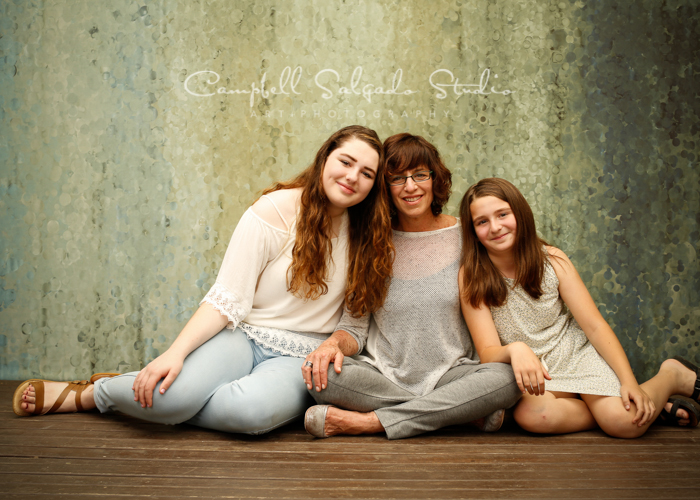 Portrait of mother and daughters on rain dance background by family photographers at Campbell Salgado Studio, Portland, Oregon.