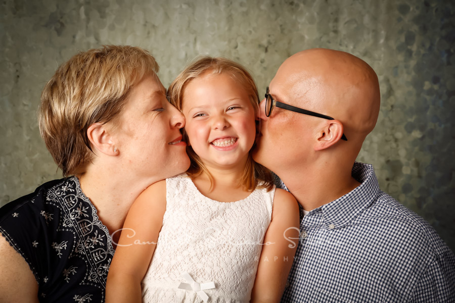 Portrait of family on rain dance background by family photographers at Campbell Salgado Studio.