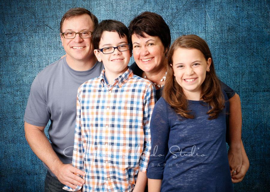Portrait of family on denim background by familyphotographers at Campbell Salgado Studio in Portland, Oregon.