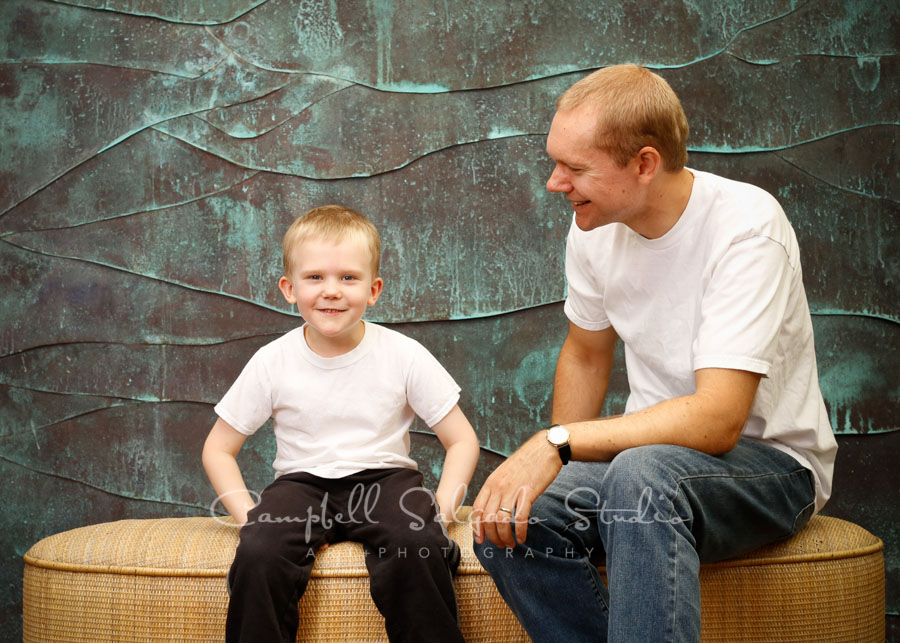 Portrait of father and son on copper wave background by family photographers at Campbell Salgado Studio in Portland, Oregon.