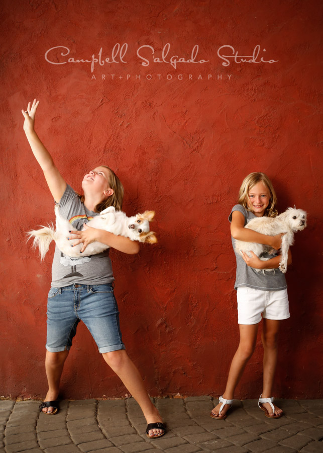 Portrait of kids on red stucco background by childrens photographers at Campbell Salgado Studio in Portland, Oregon.