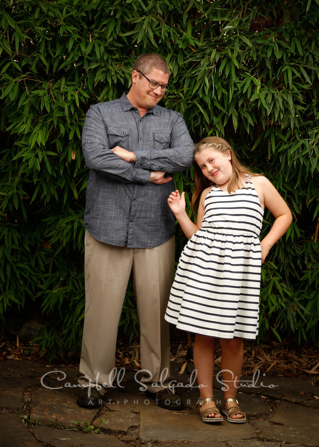 Portrait of father and daughter on bamboo background by family photographers at Campbell Salgado Studio in Portland, Oregon.
