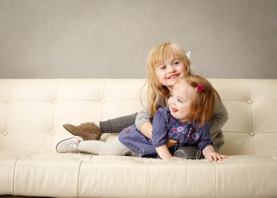 Portrait of children on modern grey background by child photographers at Campbell Salgado Studio in Portland, Oregon.
