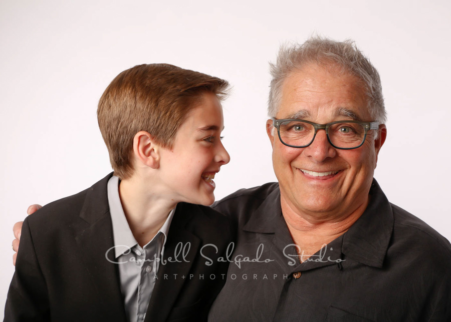 Portrait of father and son on white background by family photographers at Campbell Salgado Studio in Portland, Oregon.