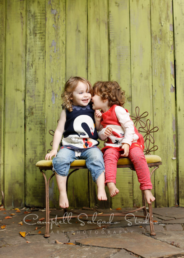 Portrait of children on lime fenceboards background by child photographers at Campbell Salgado Studio in Portland, Oregon.