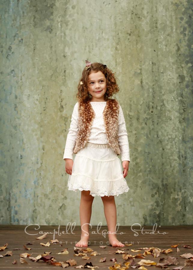 Portrait of girl on rain dance background by children's photographers at Campbell Salgado Studio in Portland, Oregon.