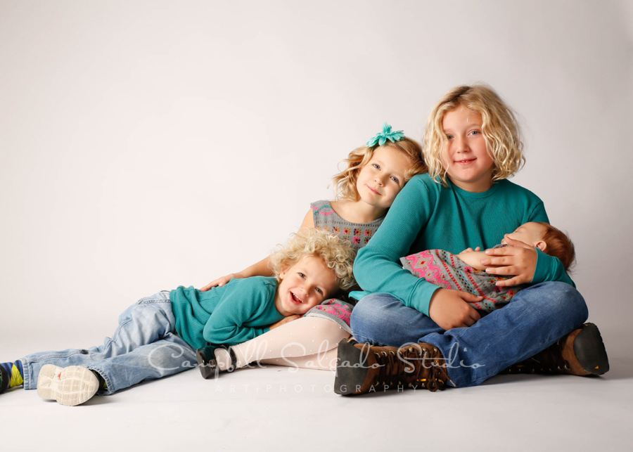 Portrait of children on white background by children's photographers at Campbell Salgado Studio in Portland, Oregon.