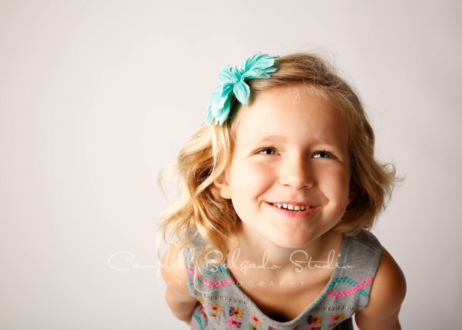 Portrait of girl on white background by child photographers at Campbell Salgado Studio in Portland, Oregon.