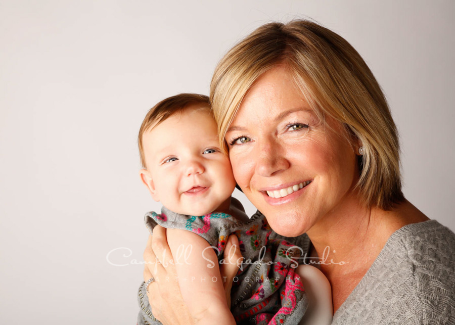 Portrait of mother and baby on white background by infant photographers at Campbell Salgado Studio in Portland, Oregon.