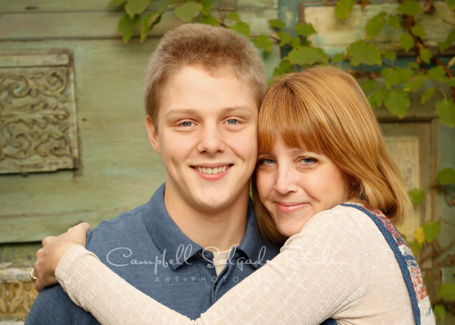 Portrait of mother and son on vintage green doors background by family photographers at Campbell Salgado Studio in Portland, Oregon.