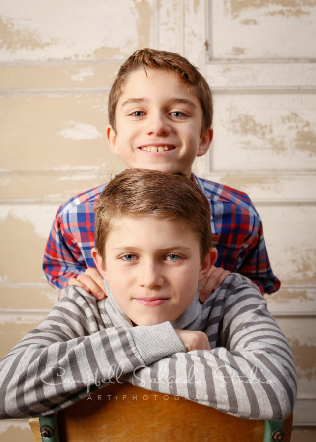 Portrait of boys on antique ivory doors background by child photographers at Campbell Salgado Studio in Portland, Oregon.