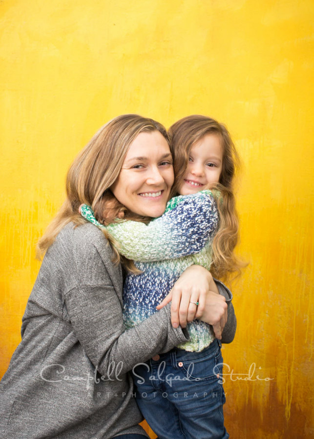 Portrait of little girl and mom on liquid sunshine background by family photographers at Campbell Salgado Studio in Portland, Oregon.