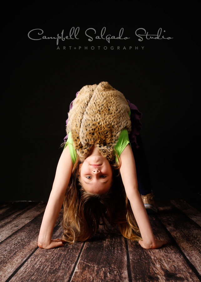 Portrait of girl on black background by child photographers at Campbell Salgado Studio in Portland, Oregon.