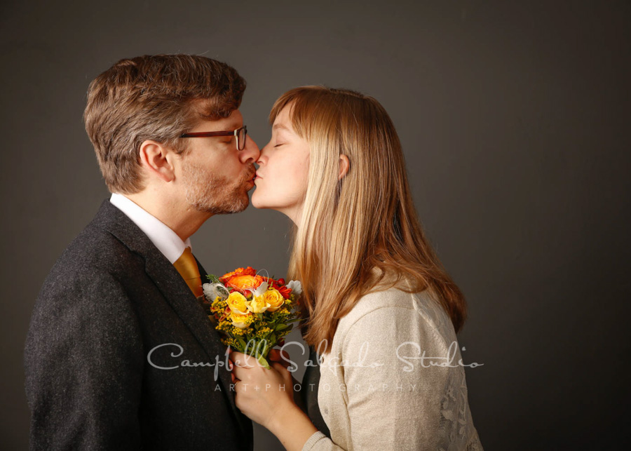 Portrait of couple on gray background by couples photographers at Campbell Salgado Studio in Portland, Oregon.