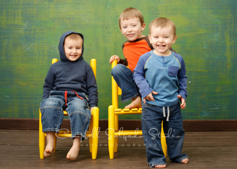 Portrait of kids on blue green weave background by children's photographers at Campbell Salgado Studio in Portland, Oregon.