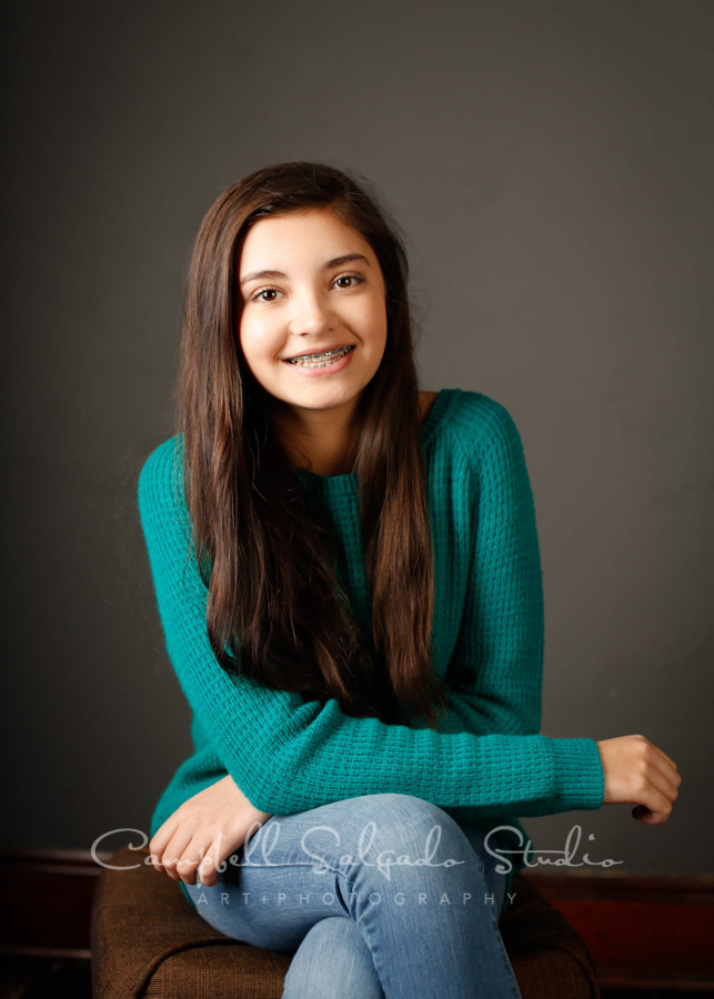 Portrait of girl on grey background by child photographers at Campbell Salgado Studio in Portland, Oregon.