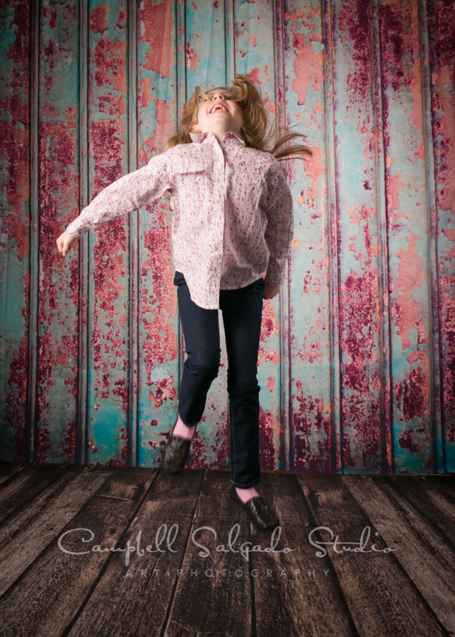 Portrait of girl on Italian rust background by child photographers at Campbell Salgado Studio in Portland, Oregon.