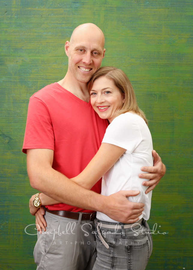 Portrait of couple on blue green weave background by family photographers at Campbell Salgado Studio in Portland, Oregon.