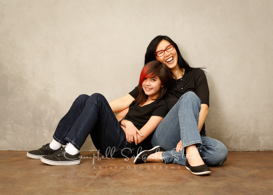 Portrait of mother and daughter on modern grey background by family photographers at Campbell Salgado Studio in Portland, Oregon.