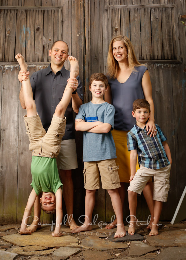 Portrait of family on brand doors background by family photographers at Campbell Salgado Studio in Portland, Oregon.