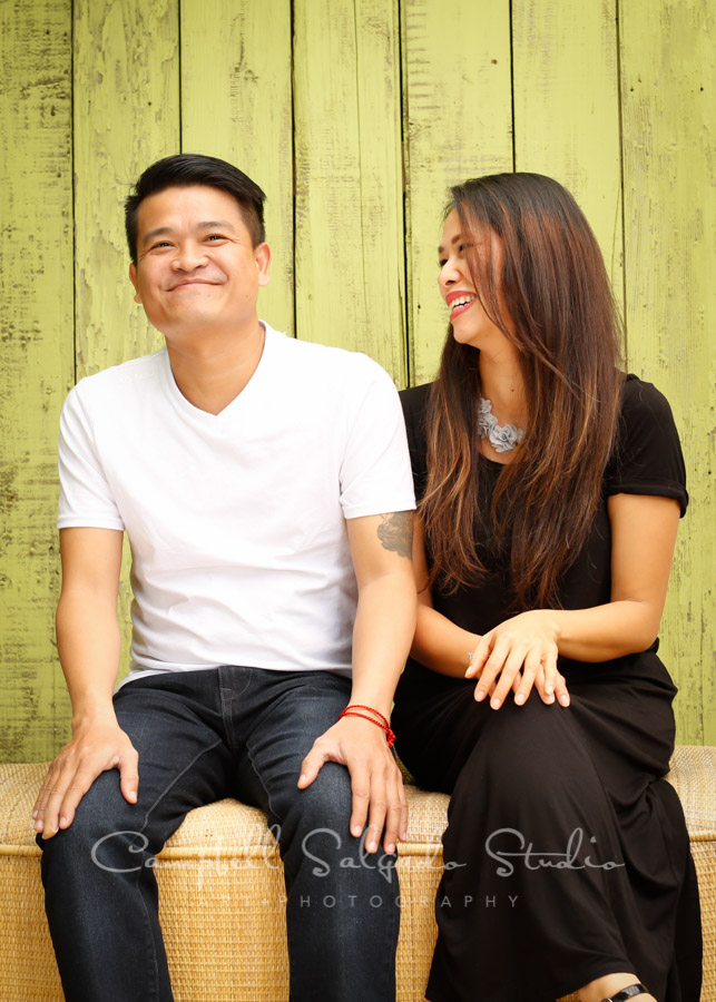 Portrait of brother and sister on lime fenceboards background by family photographers at Campbell Salgado Studio in Portland, Oregon.
