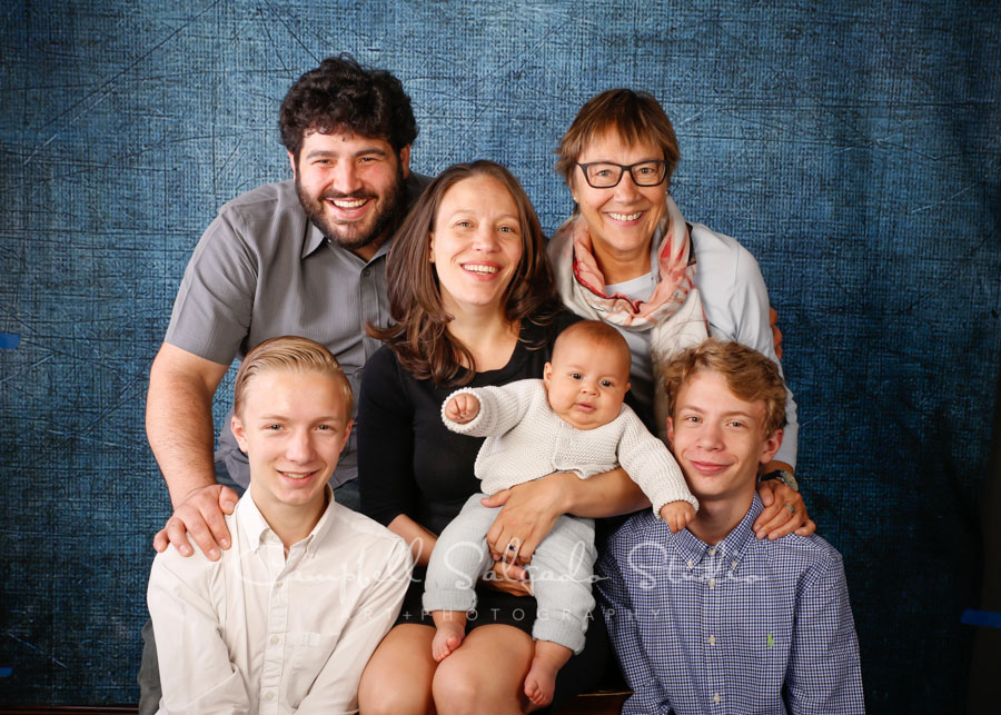 Portrait of family on denim background by famiily photographers at Campbell Salgado Studio in Portland, Oregon.
