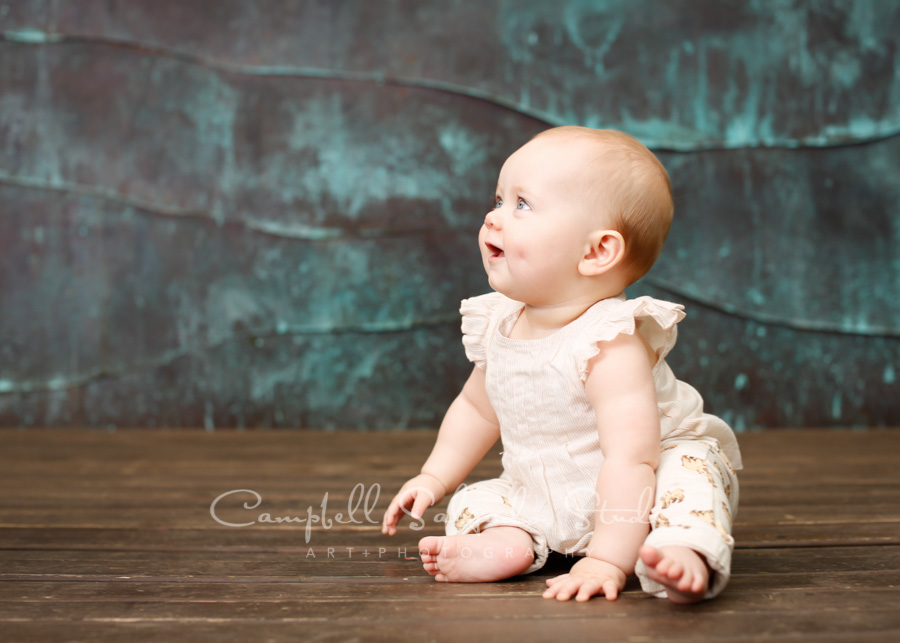 Portrait of baby on copper wave background by child photographers at Campbell Salgado Studio in Portland, Oregon.