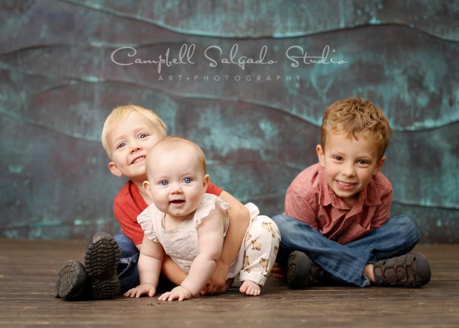 Portrait of children on copper wave background by child photographers at Campbell Salgado Studio in Portland, Oregon.