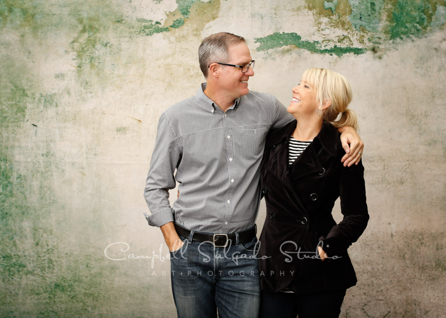 Portrait of couple on abandoned concrete background by family photographers at Campbell Salgado Studio in Portland, Oregon.