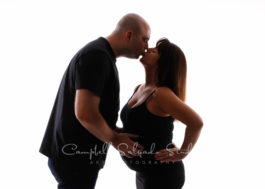 Maternity portrait of couple on white background by maternity photographers at Campbell Salgado Studio in Portland, Oregon.